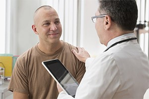 Doctor consulting with military veteran patient