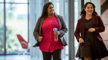 Two female employees taking a brisk walk