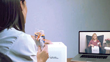 Pharmacist video chatting with someone on computer screen.