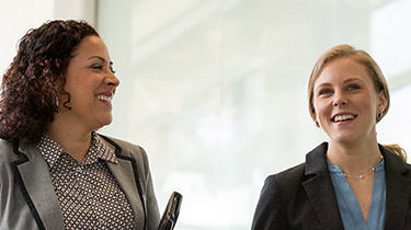 Two business women laughing